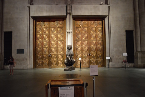 Ursus bear statue in front of Cathedral bronze doors